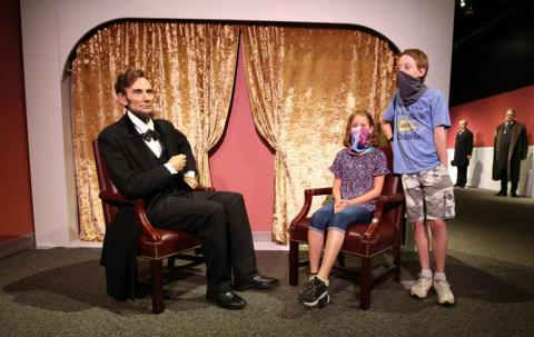 Lincoln with guests as part of the Presidents by Madame Tussauds exhibit