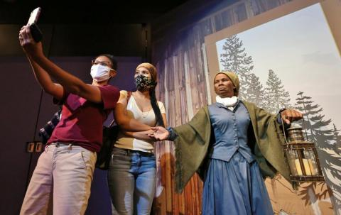Harriet Tubman with guests as part of the Presidents by Madame Tussauds exhibit