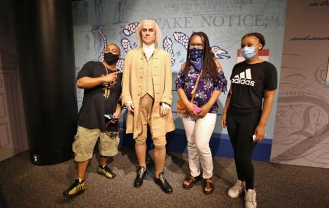 Ben Franklin with guests as part of the Presidents by Madame Tussauds exhibit