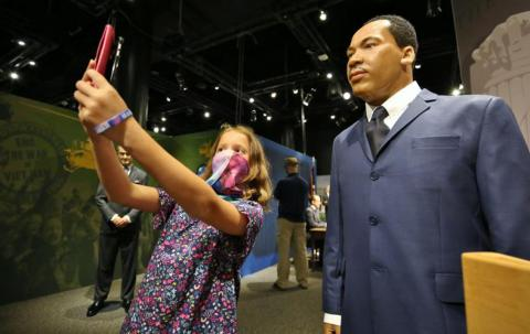 A guest with Martin Luther King Jr. as part of the Presidents by Madame Tussauds exhibit
