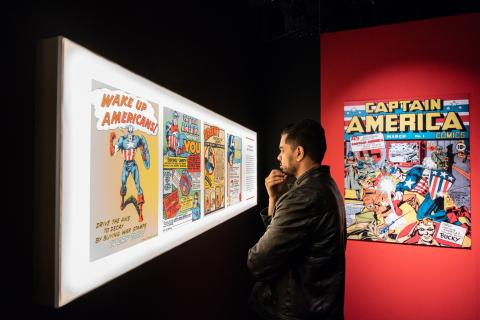 Audience viewing comic book pages at Marvel: Universe of Super Heroes