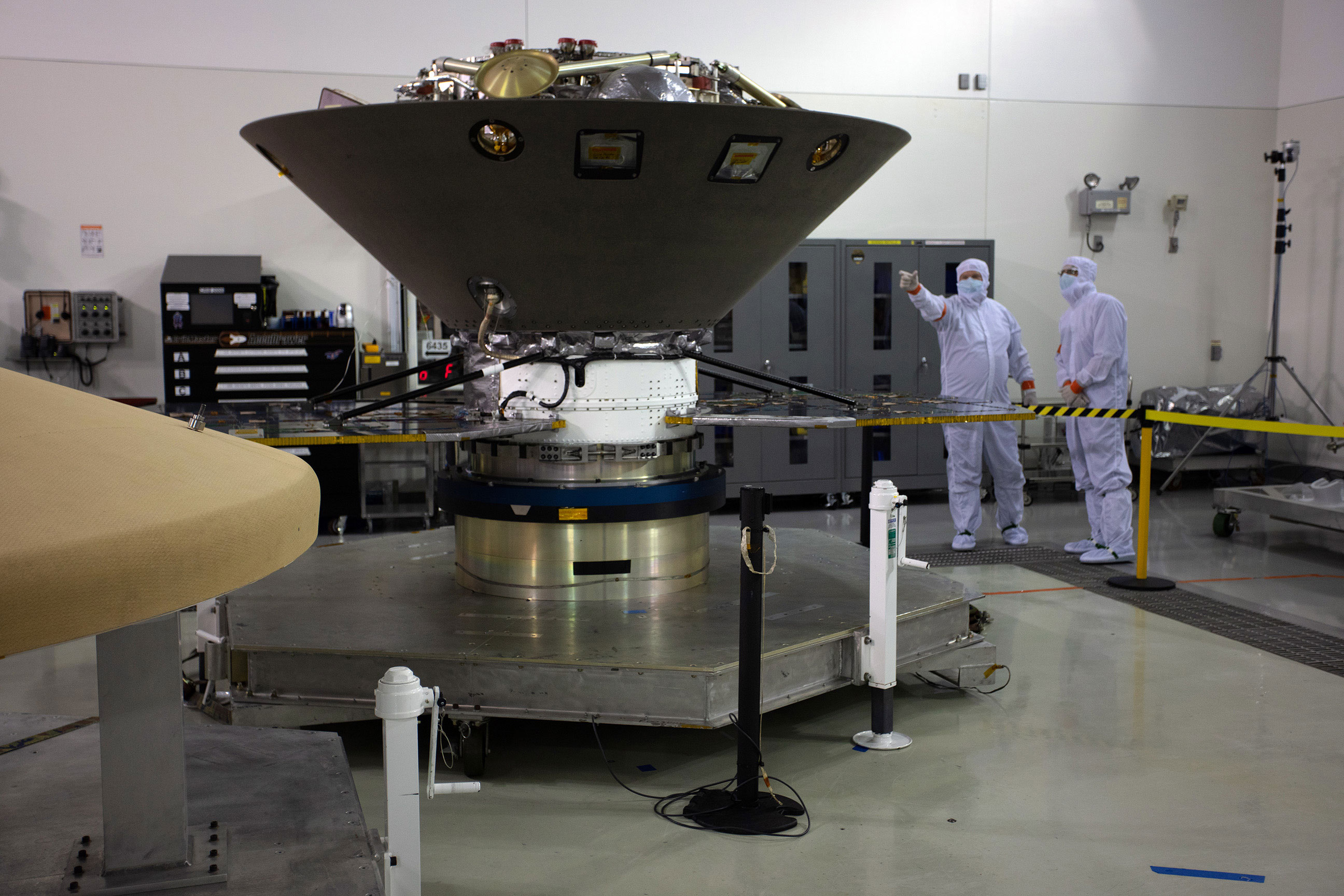 InSight in the Astrotech cleanroom at Vandenberg Air Force Base in final preparations for launch.  Only part of the lander's legs are visible above the aeroshell capsule that will protect it on the 6-month journey to Mars.  Photo: Jon Brack