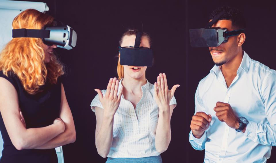 People experiencing virtual reality through headsets