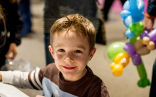 A smiling boy at The Science Behind Pixar at The Franklin Institute