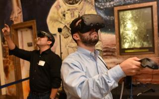 Guests experiencing virtual reality through headsets at The Franklin Institute
