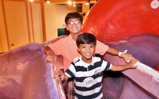 Two boys walking through The Giant Heart at The Franklin Institute.