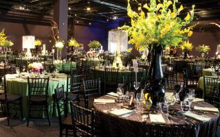 Special corporate event set up with place settings and floral centerpieces.