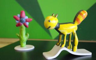 Image of 3D printed childrens art of a cat and a flower