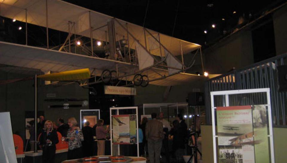 A reception being held in the Franklin Airshow exhibit at The Franklin Institute.