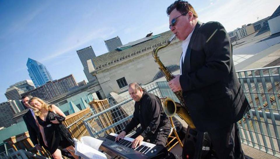 Musicians performing during an event on the Rooftop Deck at The Franklin Institute.