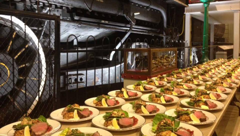 A buffet line set up in the Train Factory exhibit at The Franklin Institute.
